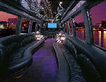 Chauffeur driven Party Bus limousine hire interior in UK