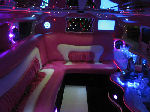 Chauffeur stretch pink Hummer H2 limousine hire interior in Newcastle, Sunderland, Durham, and North East