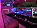 Chauffeur stretched pink Hummer H2 limo hire interior in Newcastle, Sunderland, Durham, and North East