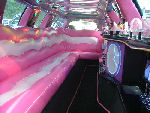 Chauffeur stretch pink Lincoln limo hire interior in Bristol, Gloucester, Cheltenham, Cardiff, Wales, Weston Super Mare, and Bath.